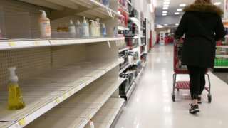 FILE - In this Tuesday, March 3, 2020 file photo, shelves that held hand sanitizer and hand soap are mostly empty at a store in Jersey City, N.J.