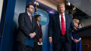 President Trump and other officials during a White House briefing