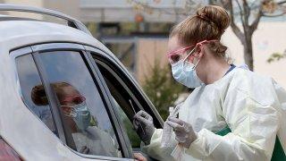 A nurse administers coronavirus testing at a drive-up facility at MedStar St. Mary's Hospital April 14, 2020, in Leonardtown, Maryland.