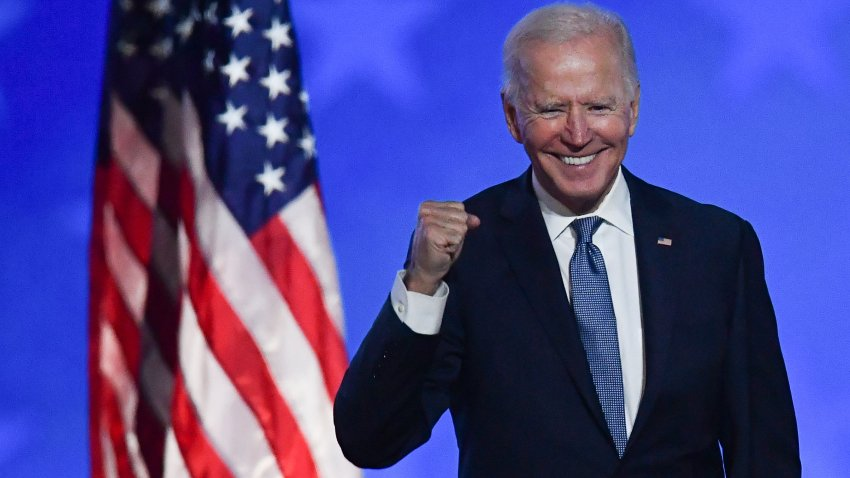 "Democratic presidential nominee Joe Biden gestures after speaking during election night at the Chase Center in Wilmington, Delaware, early on November 4, 2020. - Democrat Joe Biden said early Wednesday he believes he is ""on track"" to defeating US President Donald Trump, and called for Americans to have patience with vote-counting as several swing states"