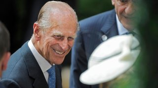 In this July 6, 2010 file photo, Prince Philip, the Duke of Edinburgh, is greeted during his visit to the British Garden at Hanover Square in New York.