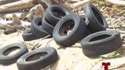 Cientos de neumáticos arropan costa de Levittown