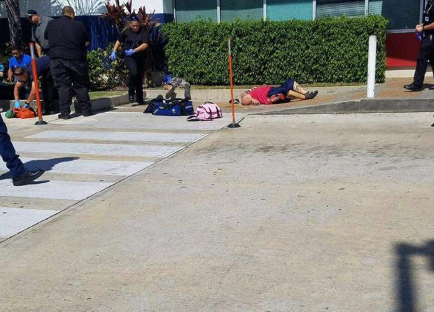 Fotos: Asesinan a dos hombres en asalto a banco